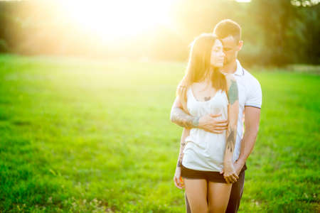 teen love: Beautiful young loving couple hugging in nature. The concept of good mood Stock Photo