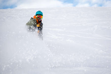 Man snowboarding on snow in the mountains