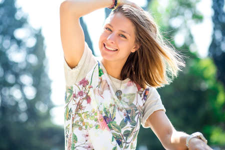 relaxed woman: Portrait of a beautiful young girl with a sweet smile. The concept of joy and fun