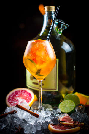 tropical drink: Beautiful and original cold fruit cocktail with fresh grapefruit, oranges, lime and ice cubes