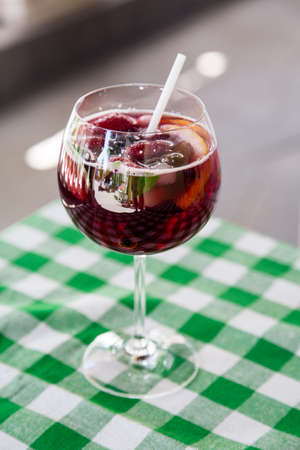 Beautiful festive cocktail with strawberries and ice in the glass