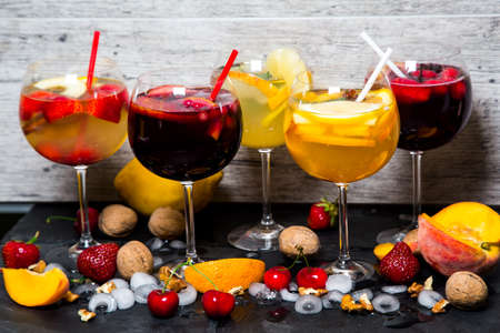 Beautiful colorful fresh cocktails with fruits and ice