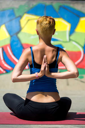 nice body: Young beautiful girl with nice body does yoga on the nature.