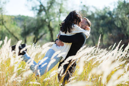life partners: Couple in love - Beginning of a Love Story. A man and a girl on the nature while walking