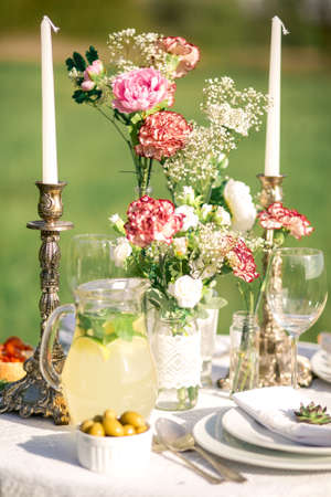 Elegant beautiful decorated table with meals and tableware at wedding reception closeup
