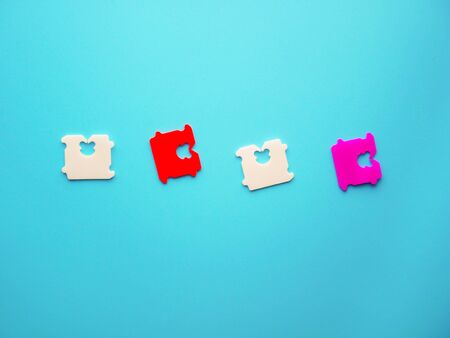 Price Tag Bread Clip on blue background. The color of plastic tags on bread bag use to tell you which day of the week bread was baked on.