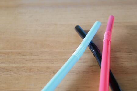 drinking straw on wood table