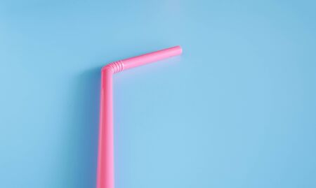 drinking straw on blue background