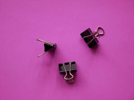 Black Binder clip on background