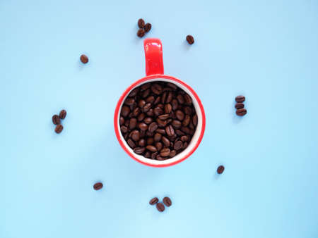 Black coffee cup on background with Coffee beans