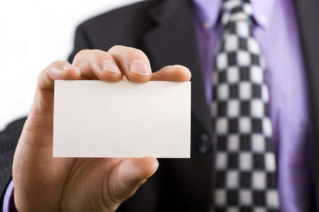 Blank business card in a mans hand photo