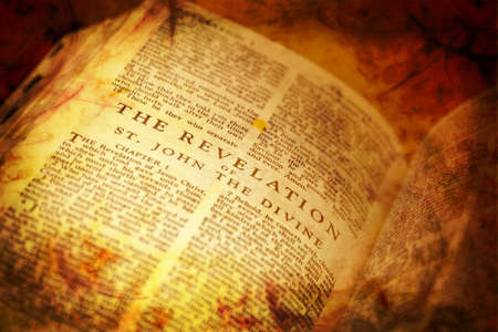 book of revelation: Bible showing The Revelation in distressed vintage style