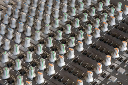 Close up of mixing console photo