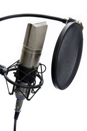 music production: Close up of studio microphone and pop shield