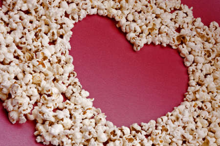 Popcorn forming the shape of a heart Stock Photo