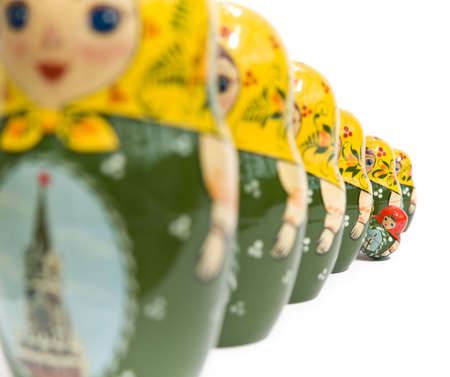 Russian dolls with one standing out from the crowd  photo