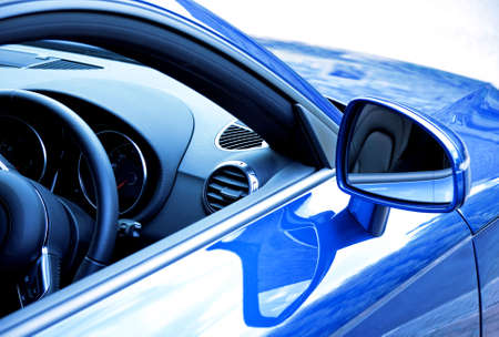 rear view mirror: Mirror and dashboard on blue sports car