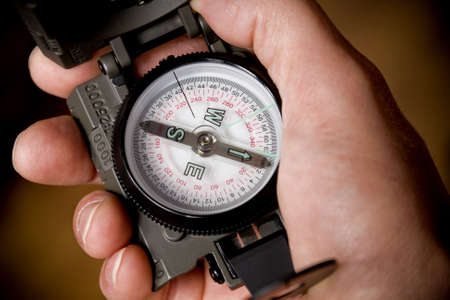 sighting: Hand of a hiker holding sighting compass