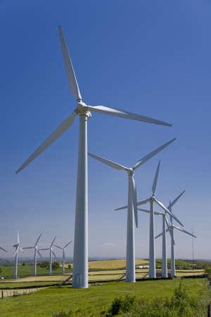 windfarm: Windmills in a windfarm against a blue sky