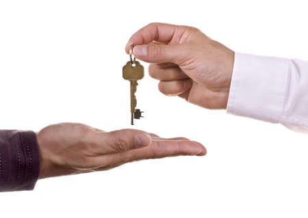 keyring: Estate agent handing over  keys Stock Photo