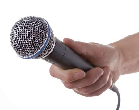 mics: Mujer presentador de la celebraci�n de un micr�fono en la mano