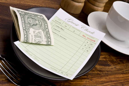 gratuity: Guest check with cash in cafe