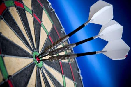 Three darts in the bulls eye Stock Photo