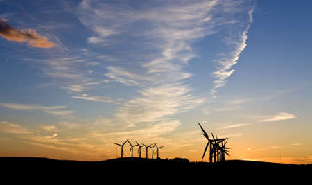 Silhouette of wind turbines against a sunset Stock Photo - 3392225