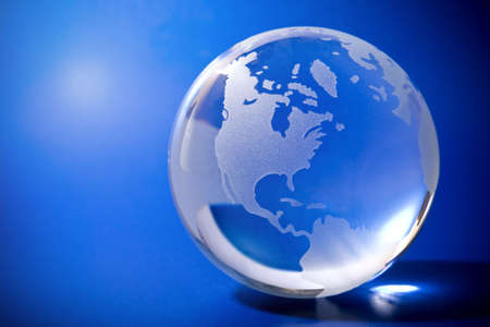 Backlit blue globe with copyspace