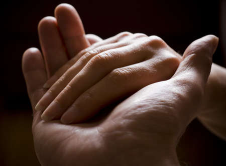 Man and woman hold each others hand