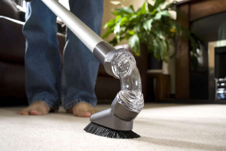 Carpet cleaning with vacuum cleaner Stock Photo