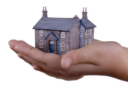 Housing market concept, house resting on a young girls hand Stock Photo - 3458461