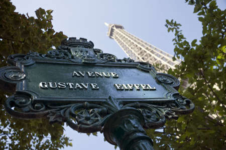 forground: Eiffel Tower with street sign in forground