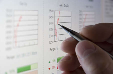 Businessman analysing share prices on the stock market Stock Photo - 3585874