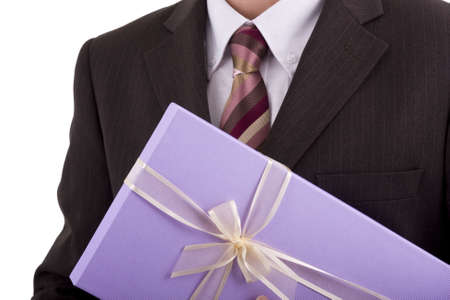 Businessman holding a gift or box of chocolates photo