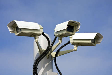 private viewing: Security cctv cameras in front of blue sky  Stock Photo