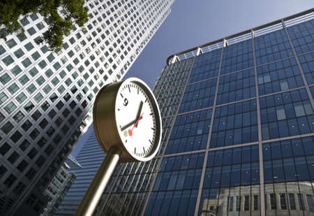 wharf: Clock at Canary Wharf in London Docklands financial district