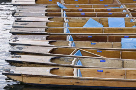 punt: Moored punts on the river Cam in Cambridge England