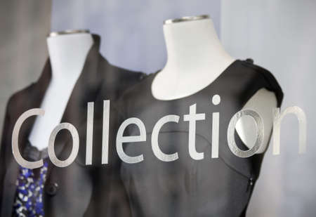 Clothes Shop window showing ladies fashion collection photo