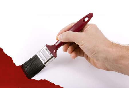 hand schilderen: Geïsoleerde hand schilderij een witte muur rode