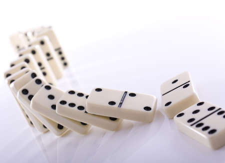 pushed: Line of dominos falling down after being pushed over Stock Photo