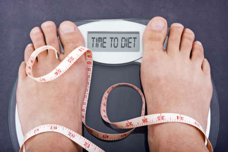 Dieting concept, bathroom scales saying time to diet Stock Photo - 3886218