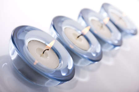 tealight: Four tealight candles on a white background