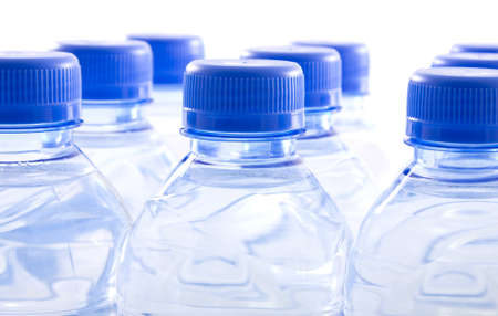 High key translucent bottled water in plastic containers photo