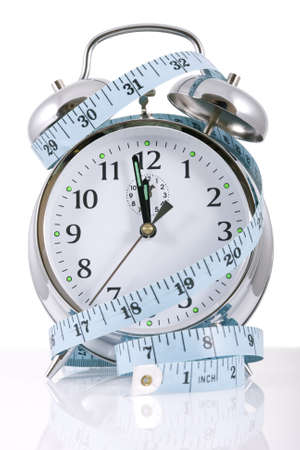 Clock and tape measure for diet concepts photo