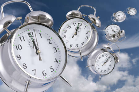 Time flying concept - alarm clocks disappearing into the distance