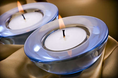 tealight: Tealight candles on a gold satin textile background