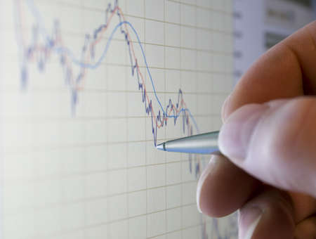 analysing: Businessman analysing share prices on the stock market