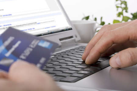 Online shopping using a credit card to complete an e-commerce transaction Stock Photo