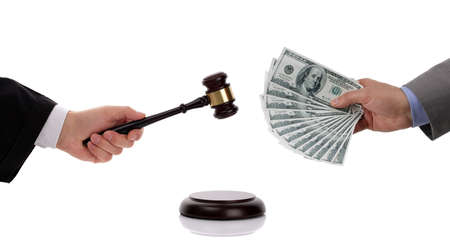 bribing: Judge hitting gavel and businessman giving one hundred dollar bills concept for corruption, business crime, bribing, fine or paying at an auction Stock Photo